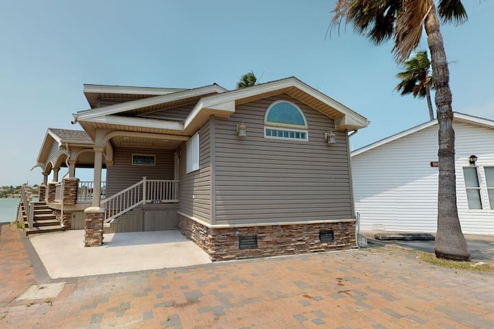 Dog-friendly waterfront home w/ dock, deck & shared pools/hot tub/gym!