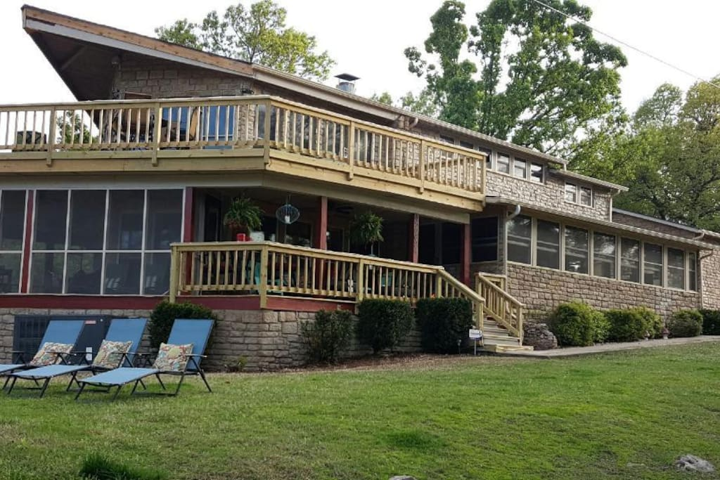 The front porch and upper balcony are great for additional seating and lake view