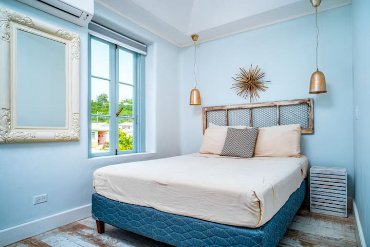 The second bedroom has island views with air-conditioning and a queen bed