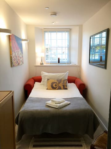 The study with a sofa bed can accommodate one or two guests, with a separate WC directly opposite, as well as an additional wardrobe for clothes storage