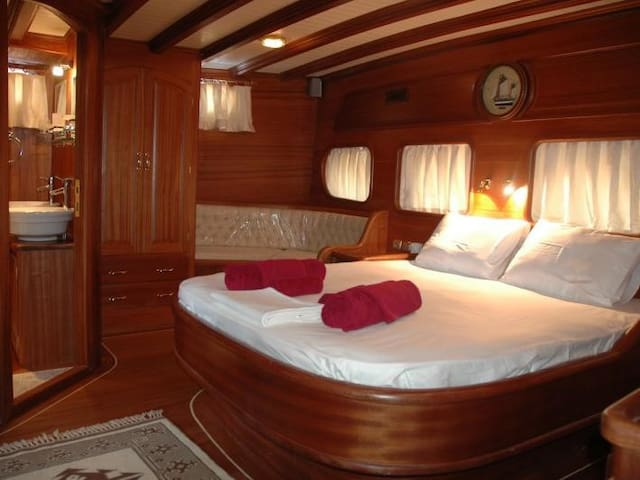 King size bed, seating and bathroom