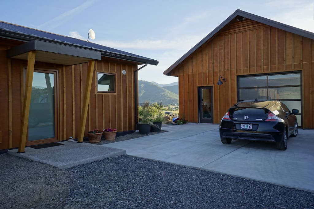 Studio private entry and parking.