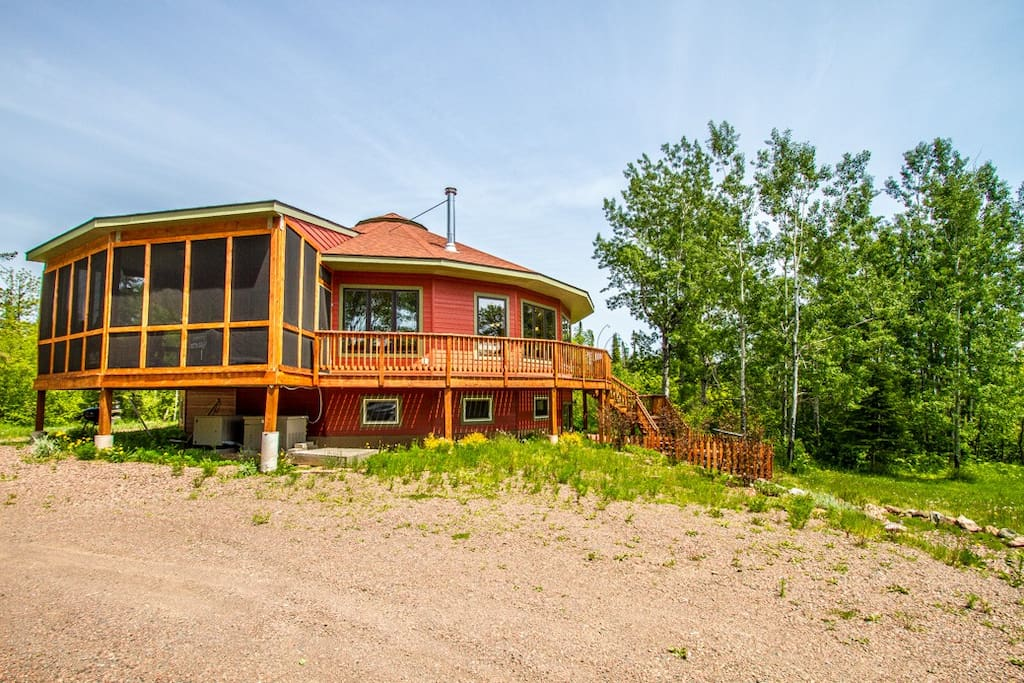 Roundhouse has two bedrooms, one bathroom, and a spacious open living area, plus a 3-season screened-in front porch.