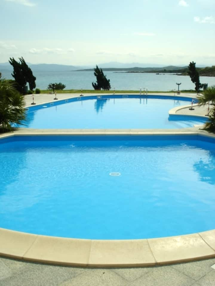 Apartment with 2 bedrooms in Golfo Aranci, with wonderful sea view, private pool, terrace - 200 m from the beach