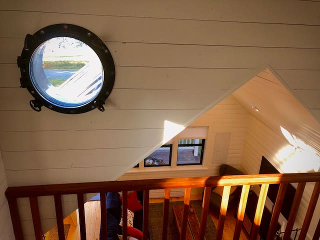 The loft view below and round window to see out.