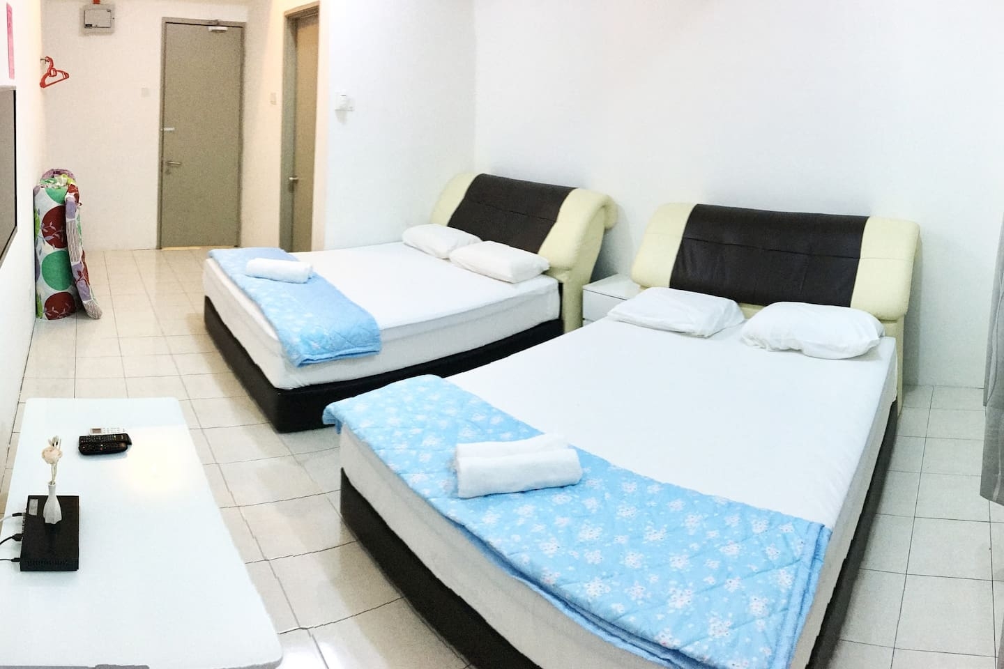Two queen beds - One bathroom - Air conditioner - Television - Mini refrigerator  - Complimentary bottled water - Hair dryer - towels and soaps