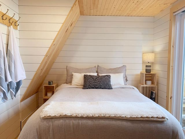 Bedroom. Double bed, slider door to private patio and outdoor shower. Private entrance to bathroom.