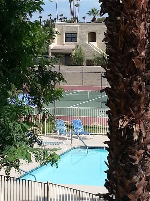 Tennis court just beyond pool