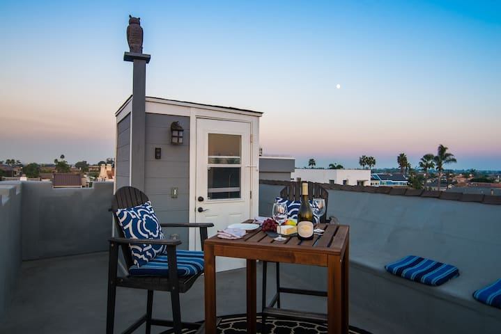 Relax on the roof top deck with a glass of wine and a 360 degree view of the ocean and the mountains.