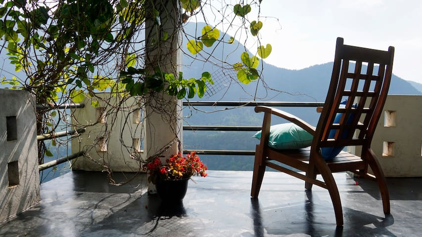 Enjoy local tea from our terrace overlooking the Saptha Kanya mountain range and Laxapana Waterfalls