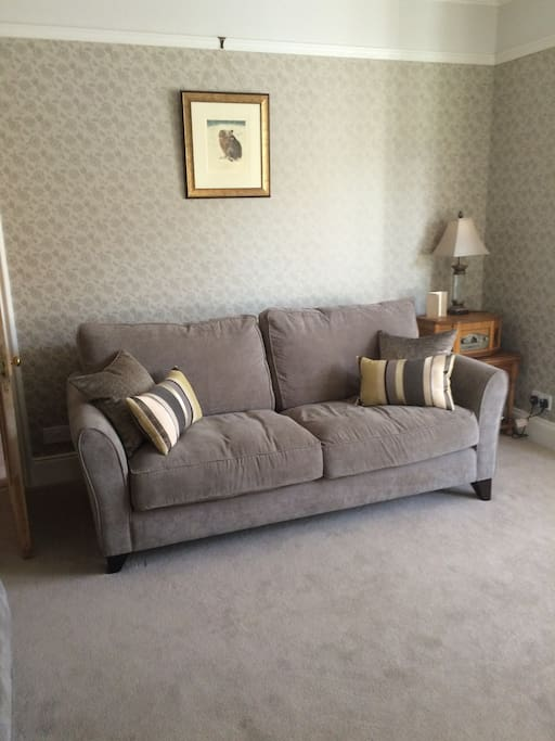Comfortable settees add to the relaxing atmosphere of the sitting room