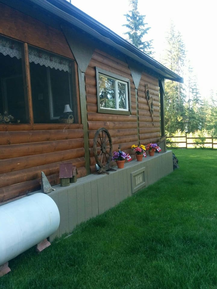 View of the cabin with screened in porch