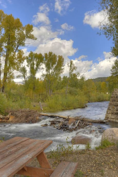 Durango Colorado waterfront vacation rental cabin river pond fly fishing canoe picnic table on river island