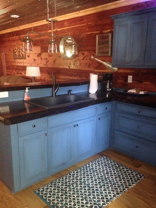 Custom kitchen cabinets with full size refrigerator with ice maker and standard flat top stove.  No dishwasher.