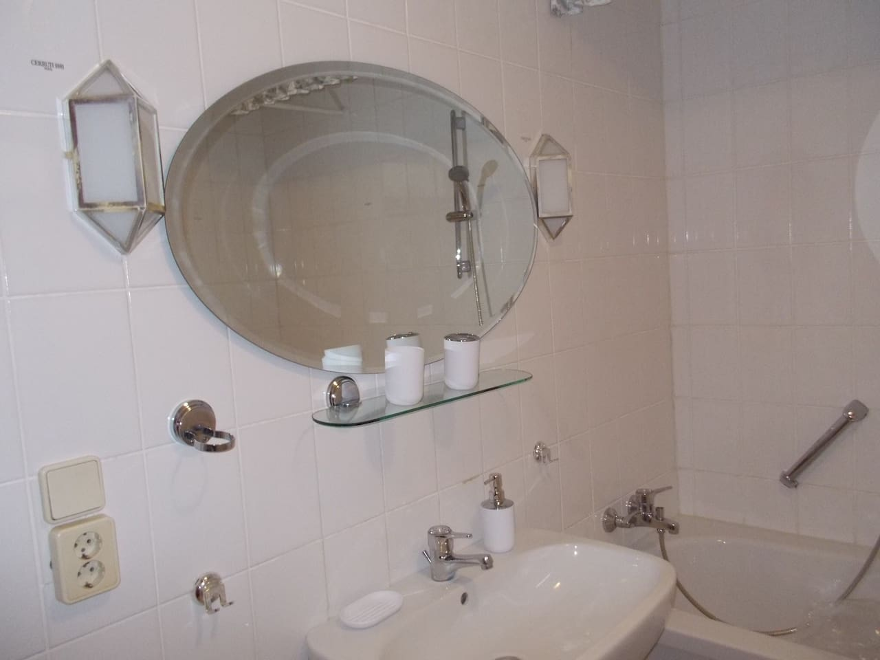 Own bathroom with bath tub, shower and toilet