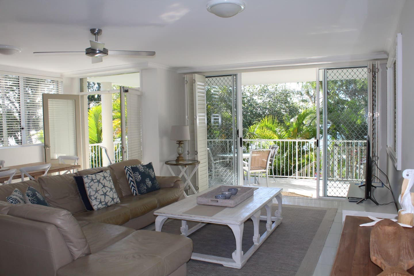Lounge/Dining area with views from Balcony to Noosa River