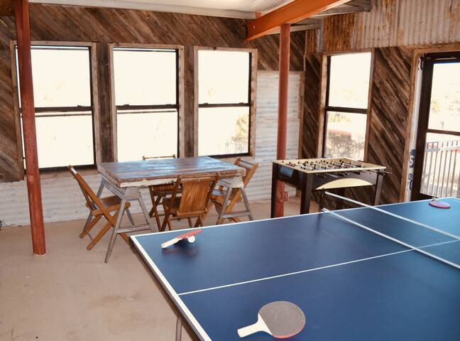 Enter up the stairs into the gameroom with ping-pong, foosball, and a game table overlooking the lake.