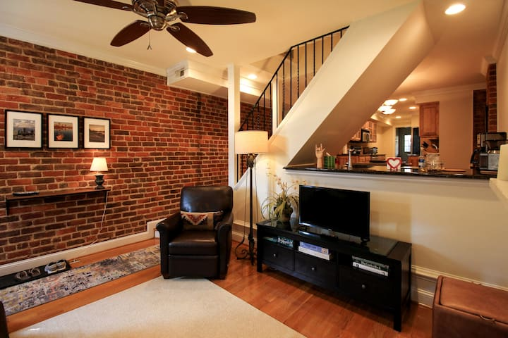 One hundred forty year old brick walls add character to living and dining rooms on first floor.