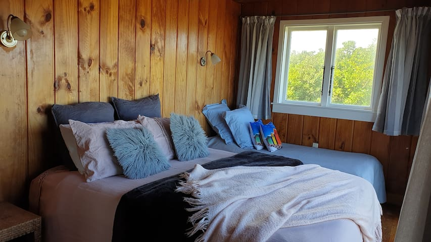 A Queen and single bed in this room.  The couch in the lounge converts to another double bed and there is a camp stretcher for children.