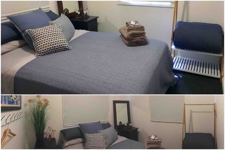 Bedroom 2 - The Blue Room is another very comfortable queen bed with good quality linen and furniture. There is a ceiling fan, a modern clothes hanging stand and a good sized mirror.