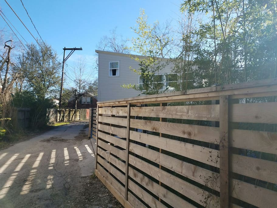 The townhome is situated behind a modern gate.