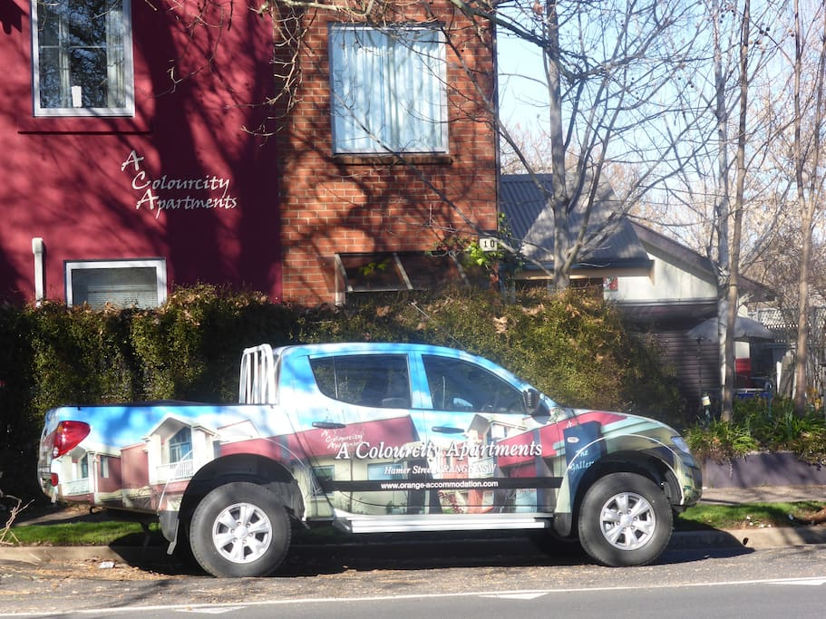 A Colourcity apartments courtesy vehicle outside The Lawson apartments building in winter