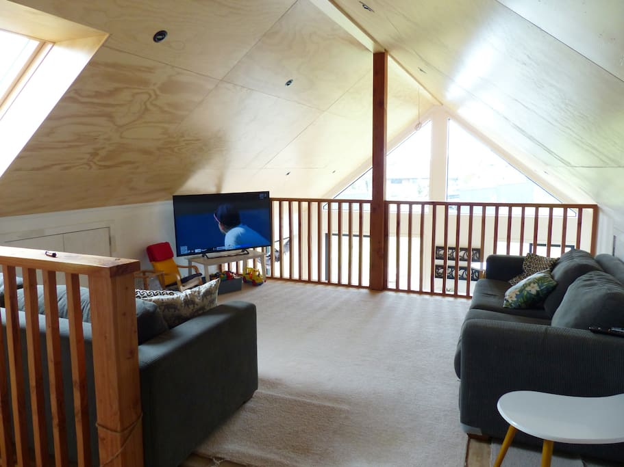 Lofted lounge and TV area.