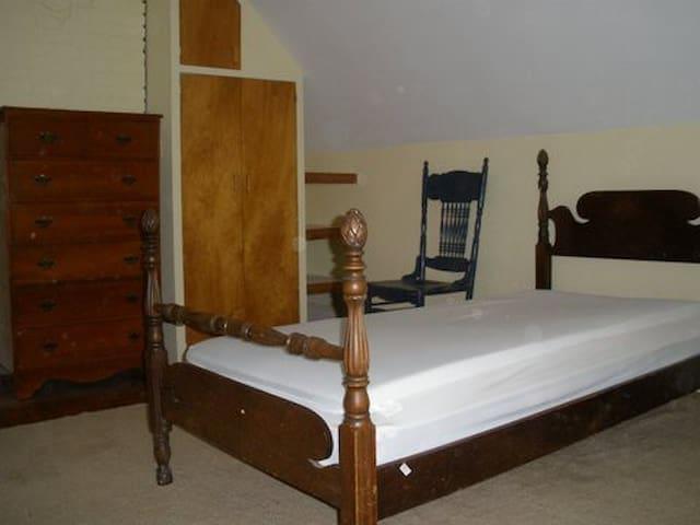Third floor bedroom with antique single bed