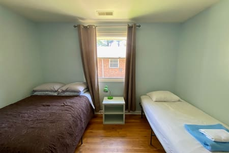 Bedroom 1 has a twin and full bed that sleep up to 3 guests.