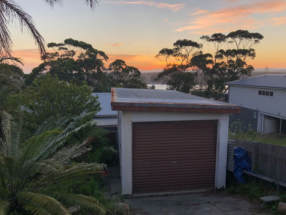 You'll have privacy and the whole property to yourself. This is the street we're on, and the house is below the garage you see. There's a bush path at the end of our street, that takes you to   Racecourse Beach