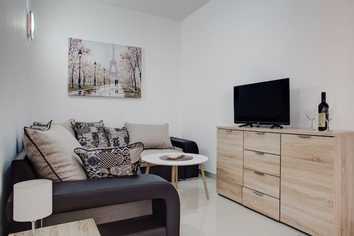 Living room area with cable TV.