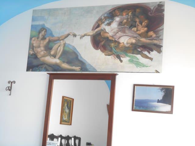 camera  MICHELANGELO: la creazione di Adamo.