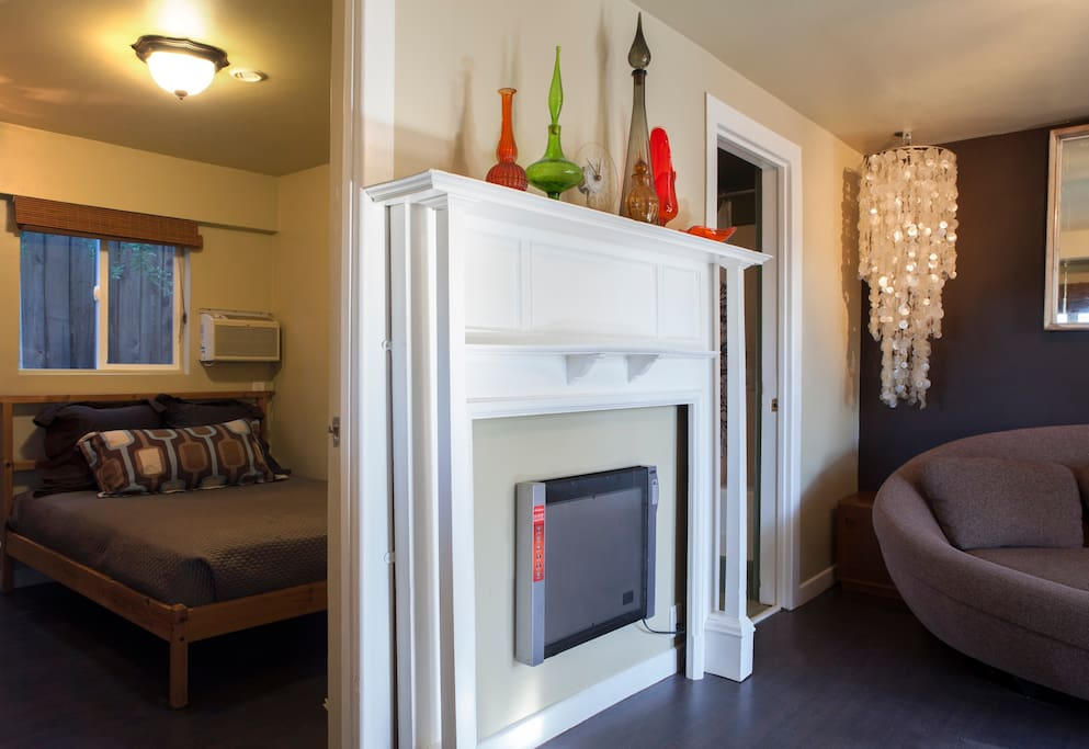The heater inside the fireplace mantle and a bedroom view. Queen size memory foam bed with luxury linens.