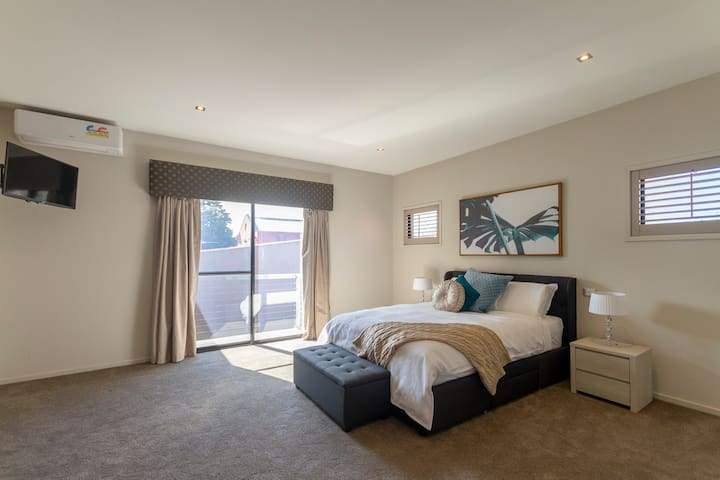 This is the master's bedroom with a queen sized bed located on the second floor. It has a new smart TV with Netflix and new airconditioning.