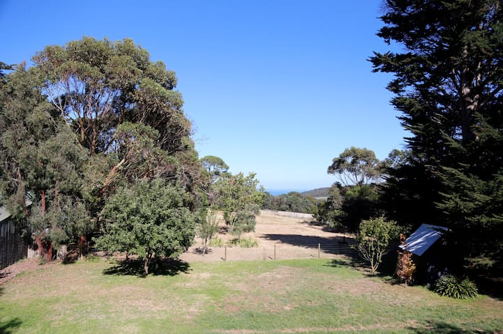 The view of the paddocks and Port Phillip Bay from the master bedroom