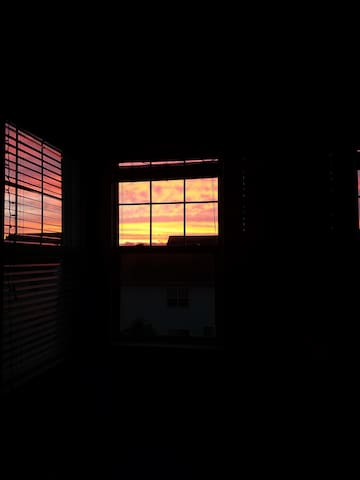 Beautiful sunsets from this room as the sun sets directly behind the house