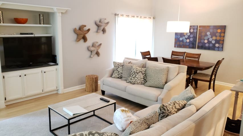Large great room with lofted ceiling adds to spaciousness of villa.