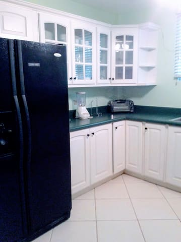 Kitchen. Large refrigerator. Also equipped with all basic pots, pans, utensils etc if you're someone who enjoys cooking!