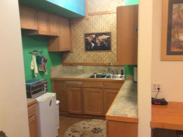 Kitchenette with double sink, mini fridge / freezer, microwave, coffee maker, and toaster!
