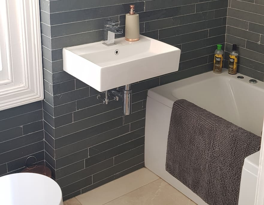 natural stone bathroom,  chic and newly refurbished