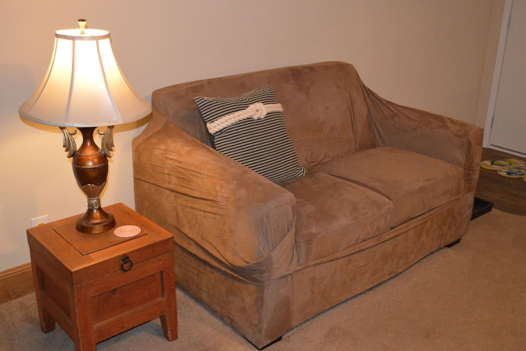 Love seat in living area