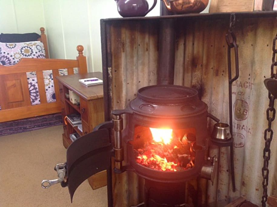 Roaring fire to keep you warm - PLUS you can cook on it!