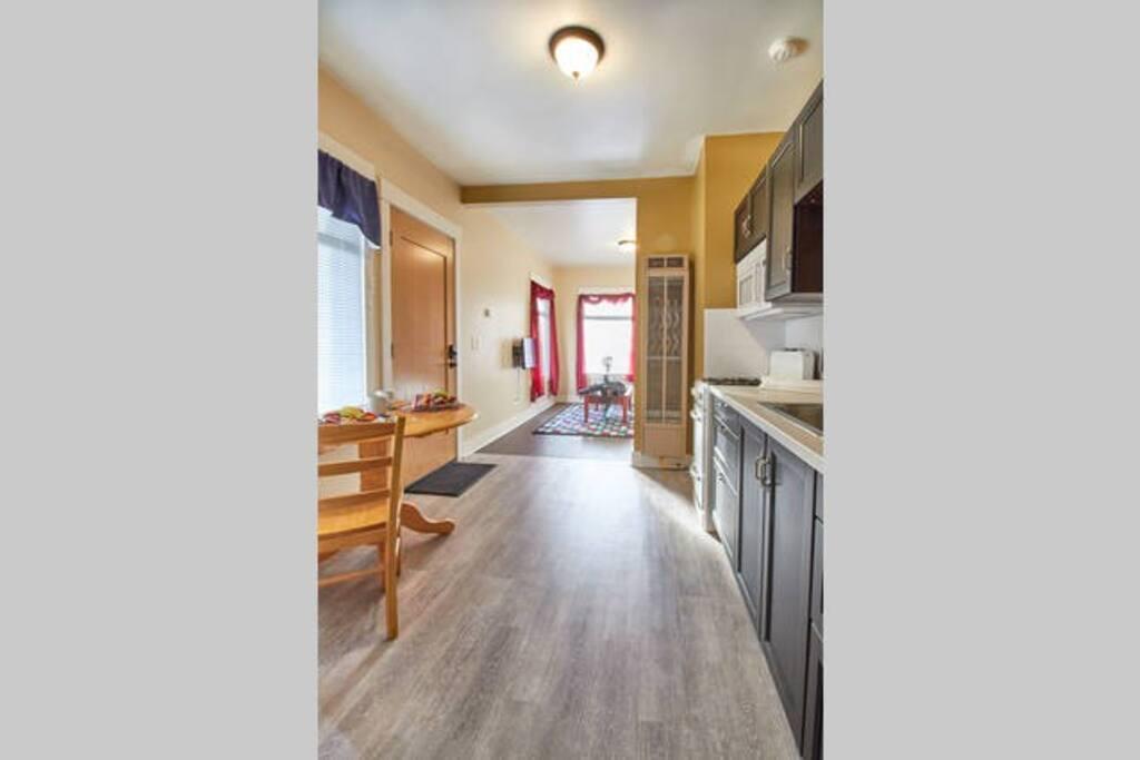 Full kitchen - range, microwave, refrigerator.