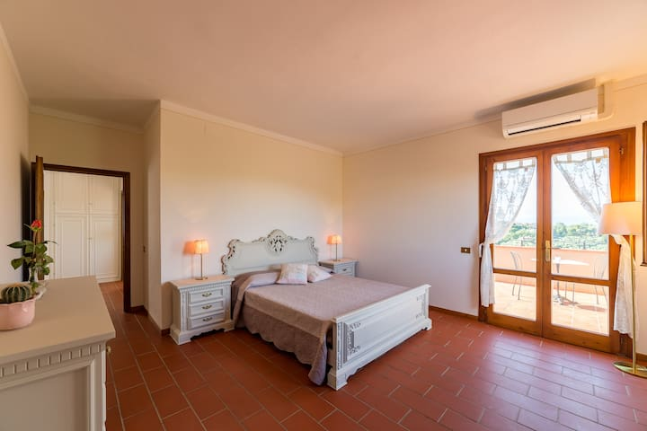 First floor: Bedroom 1 with double bed, ensuite bathroom with shower and access to panoramic terrace