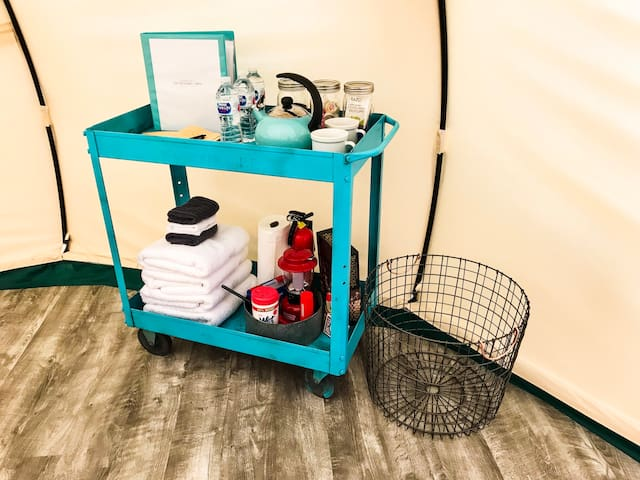 We provide a guest amenity cart with fresh towels, camp lantern, kettle, French press and coffee supplies, board games, and more for your perfect glamping getaway!