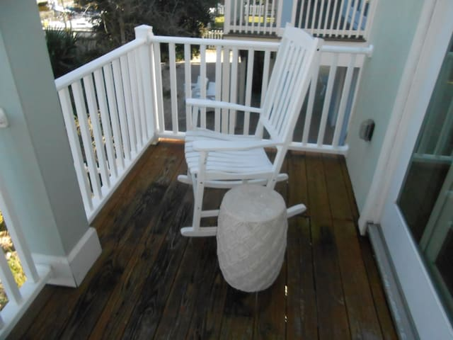 Back balcony overlooking boat dock and off of dining room