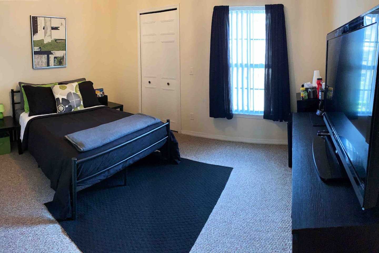 The private room comfortably sleeps 2 with lots of luggage storage space, extra linens/blankets/pillows, bedside nightstands/lamps/outlets, dresser, TV, mini fridge, microwave, coffee station, curtains, ceiling fan and closet.