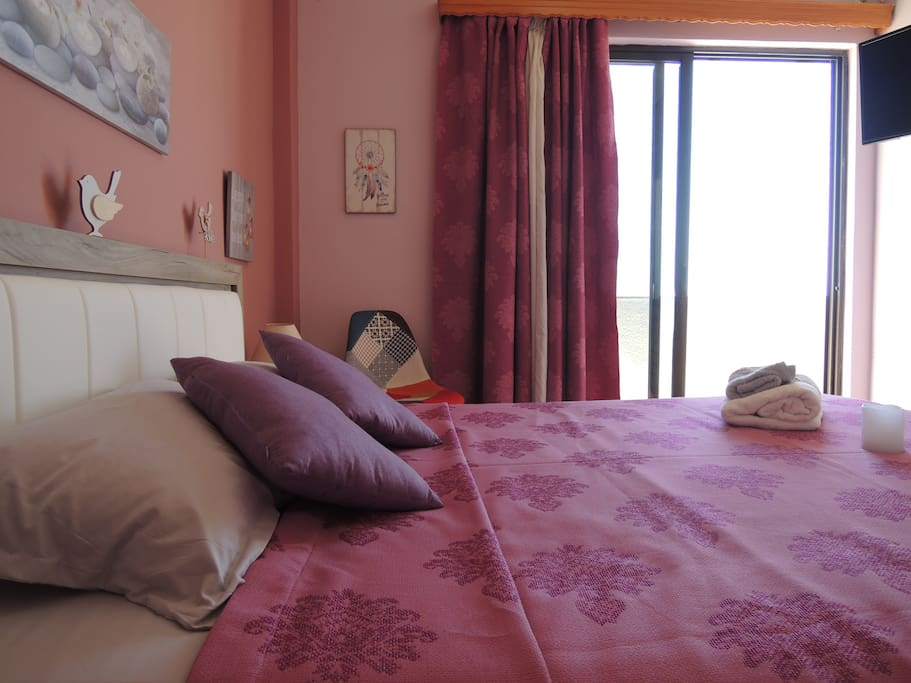 Bedroom with comfortable double bed with view