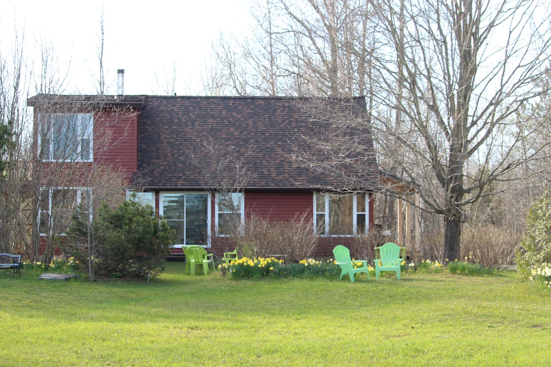 Newly sided and shingled cottage.