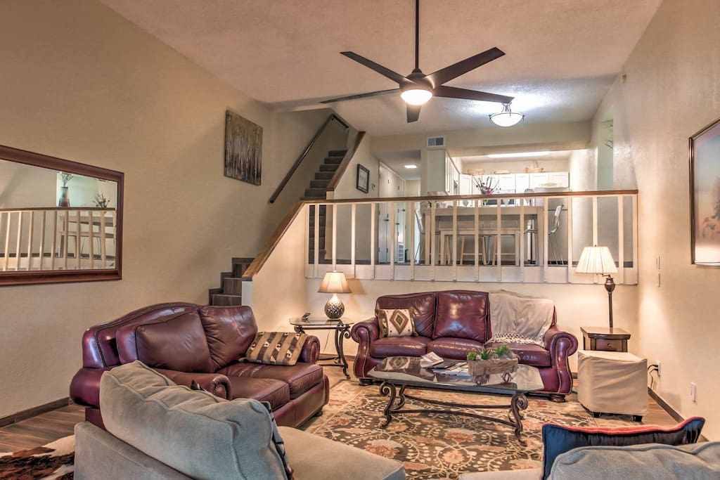 The modern condo features an open floor plan with comfortable furnishings.